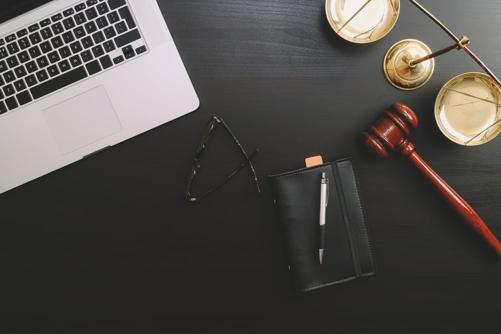 Attorney desk with laptop and gavel illustrating the issue of cybersecurity for the legal industry