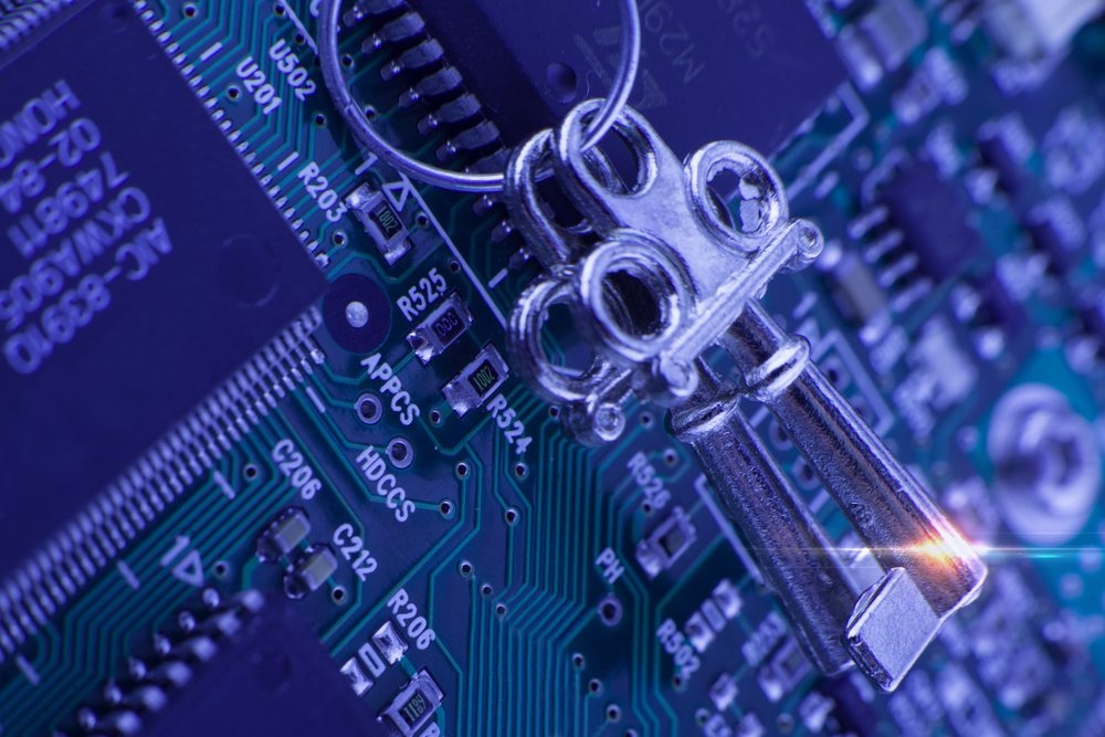 Computer board with two keys on a ring, illustrating next-generation firewalls for risk management and protection from cyber threats.