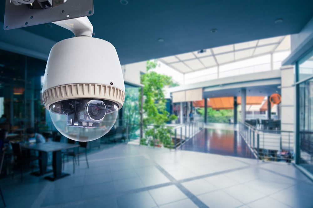 Video surveillance camera in a retail location. Video surveillance equipment may be prone to privacy breaches and should be secured with end-to-end encryption.