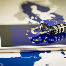 Smartphone and padlock on top of an EU map, representing the level of data protection required to be in compliance with the General Data Protection Regulation (GDPR).